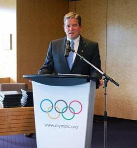 photo of Matt Robinson speaking at IOC HQ