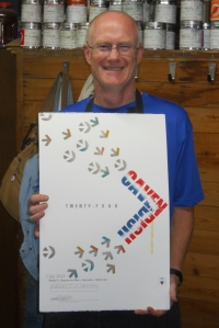 photo of Mark Deshon with poster