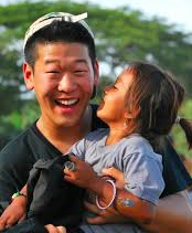 photo of Enoch Lee and little girl