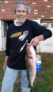 photo of Skip White with striped bass