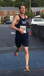 photo of Bruce Weber finishing race