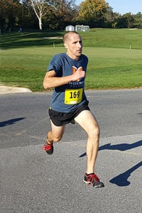 photo of Andrew Weber finishing 5K