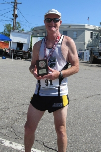 photo of Mark Deshon with age-group winning plaque
