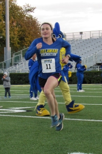 photo of Jo Baird finishing Homecoming 5K