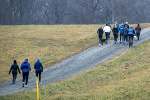 photo of runners heading uphill