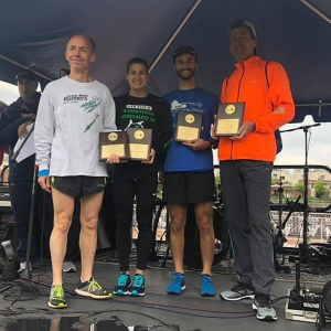 photo of relay team with plaques