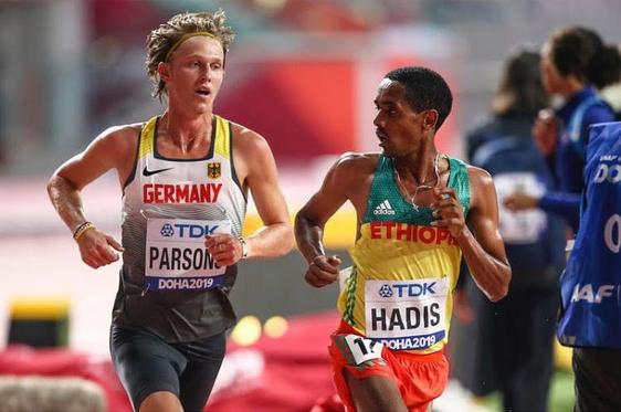 photo of Sam Parsons making eye contact with an Ethiopian competitor