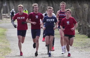 photo of Andrew Hally running with teammates, including Alex Roth